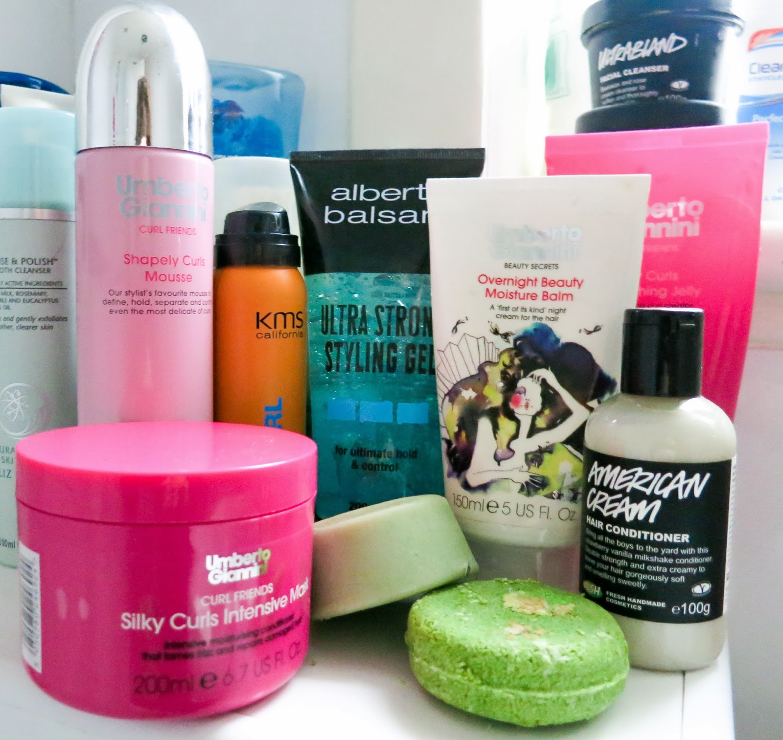 Assortment of hair products on a bathroom shelf
