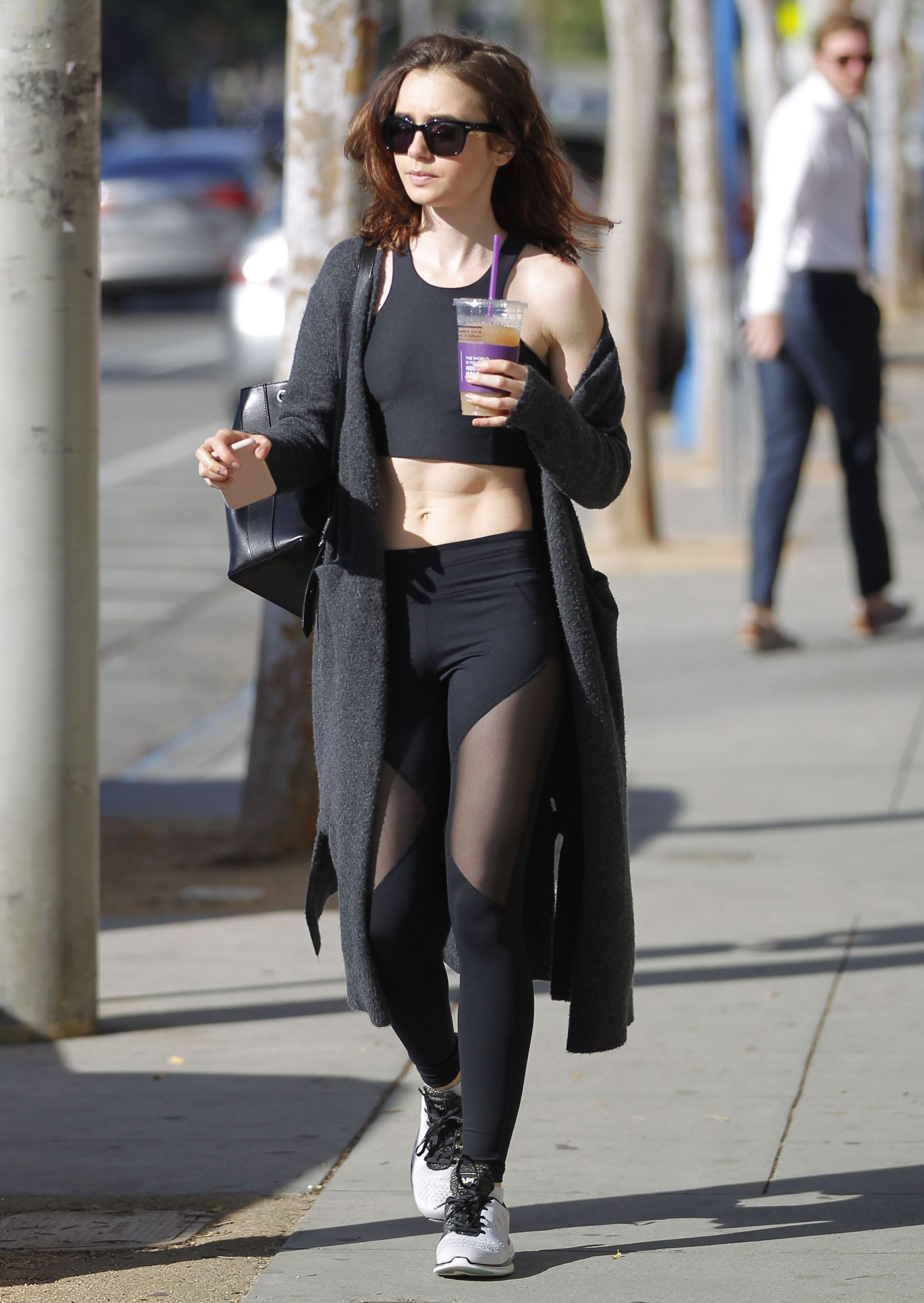 Lily Collins out after finishing gym