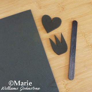 Black heart and trident shape cut from black craft foam and a stick