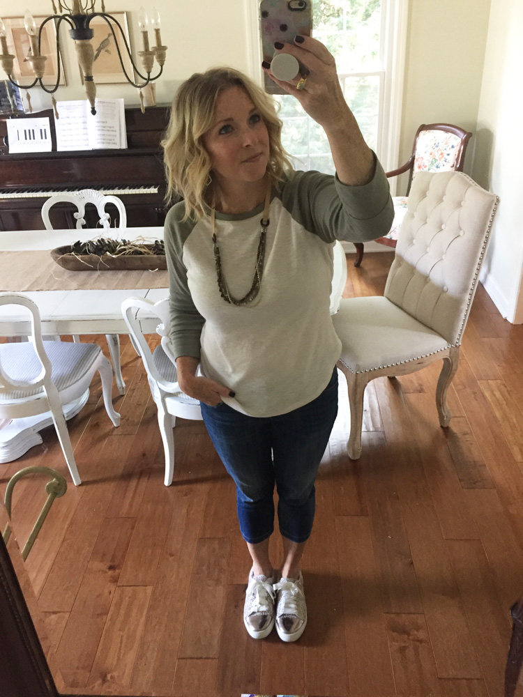 baseball tee with cropped jeans and leopard sneakers