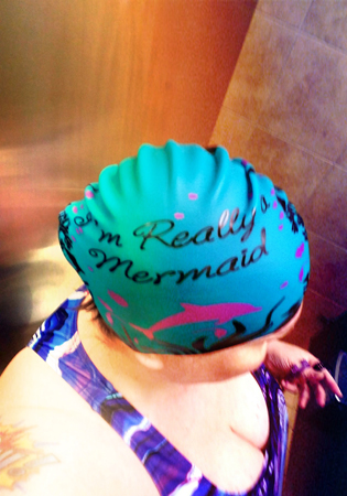 image of me from above, wearing a swimcap that reads 'I'm Really a Mermaid'