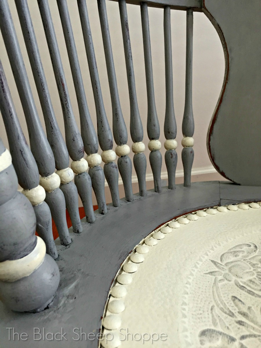 Rounded beads on spindles painted in white