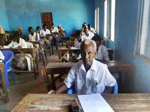 Photos of a 60-year-old Man Sitting for a Secondary School Examinations Goes Viral