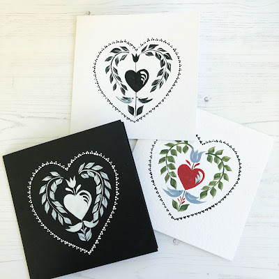 Three cards all painted using the same folk art design inspired by Valentines day in different colours.  Black on white card, white of a black card and colour on a white card.