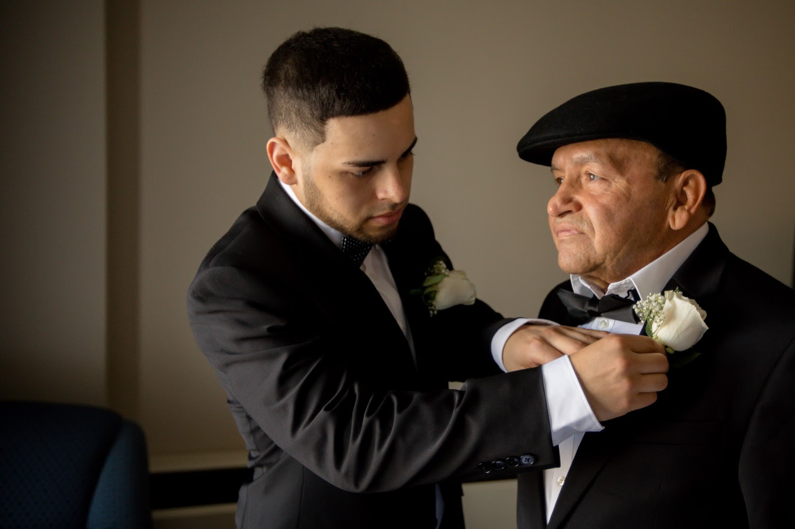 Groom Helping Father with Finishing Touches