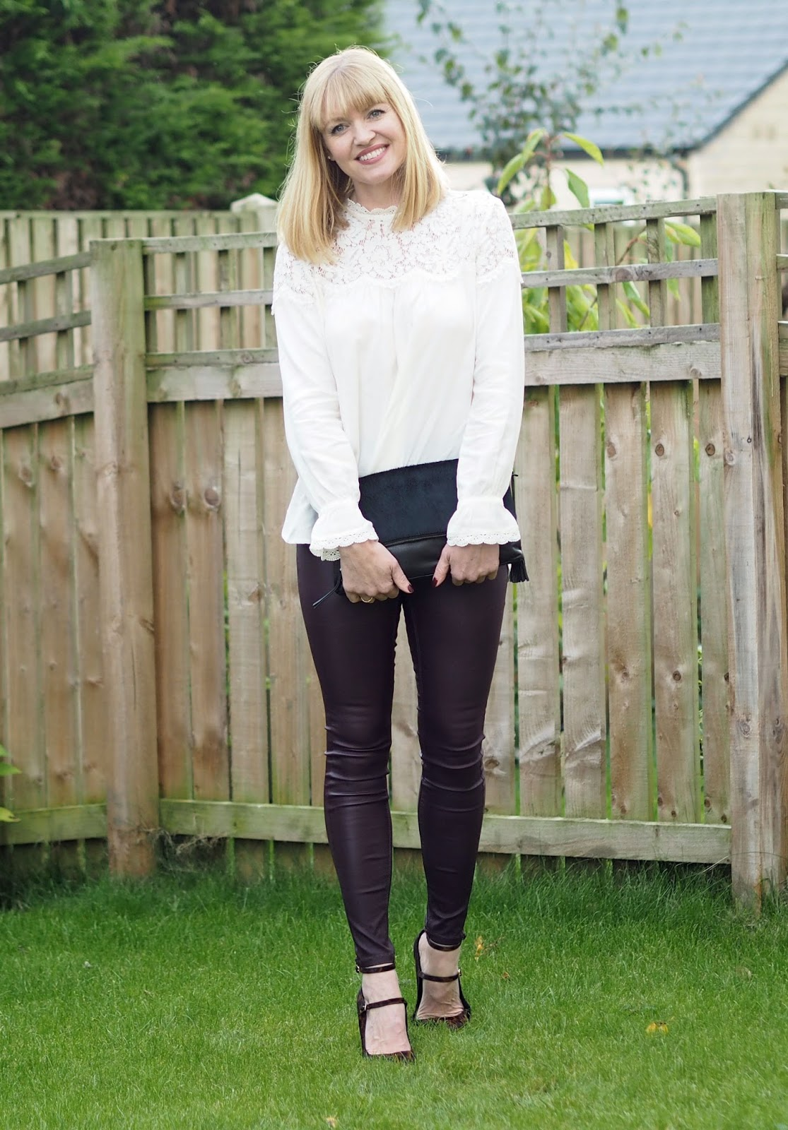 A Romantic Lace Blouse with Berry Coated Leggings and Leopard Print Heels