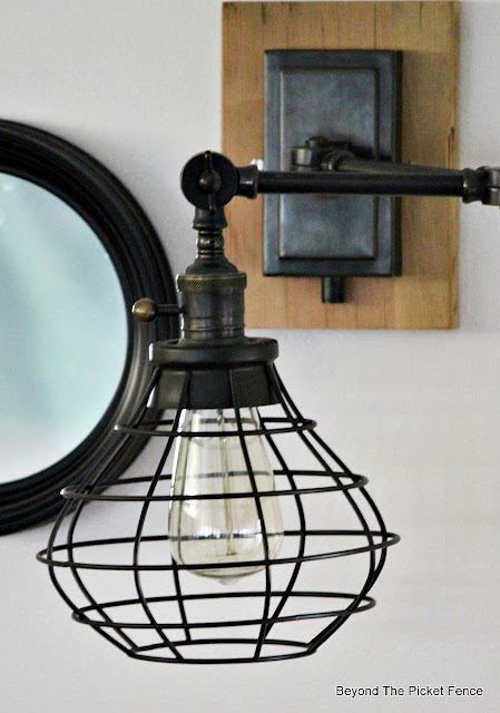 wall sconce, oil rubbed bronze, cage light, Robert Abbey, vintage, gallery wall, http://bec4-beyondthepicketfence.blogspot.com/2015/10/gallery-wall-with-awesome-light-sconces.html