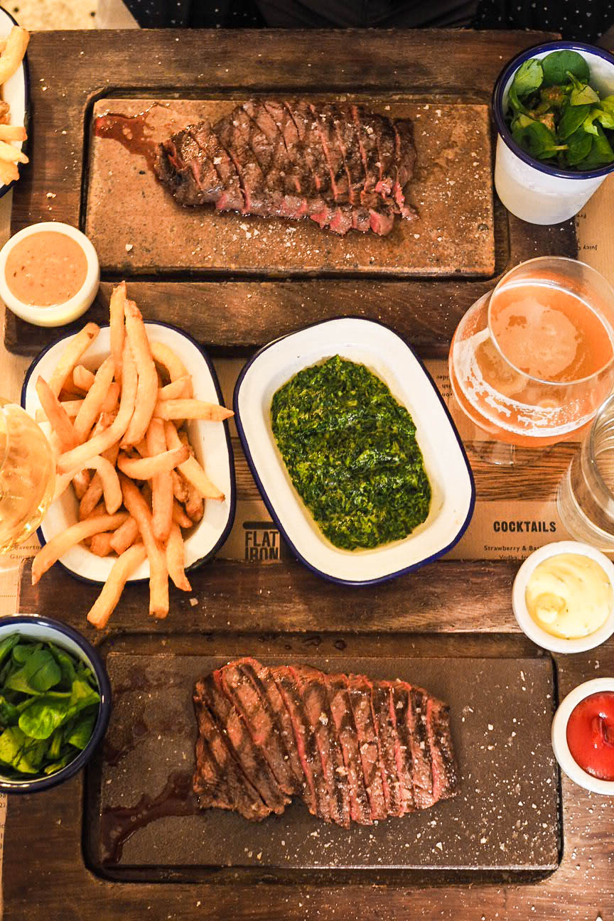 Two flat iron steaks with chips, creamed spinach and two pints of beer