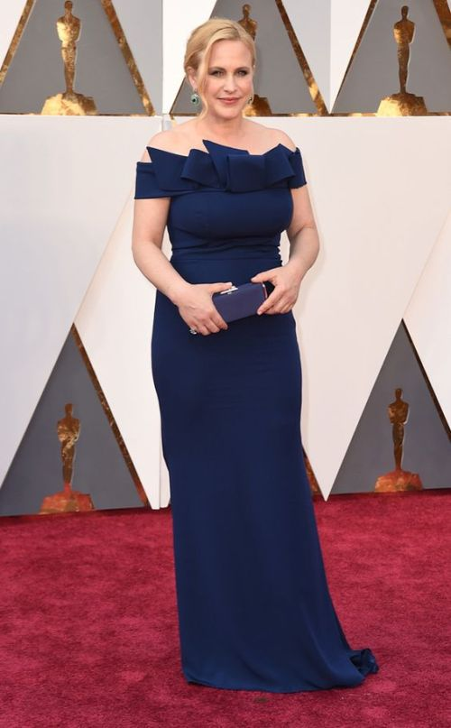 Patricia Arquette a navy bow detailed Marina Rinaldi dress at the Oscars 2016