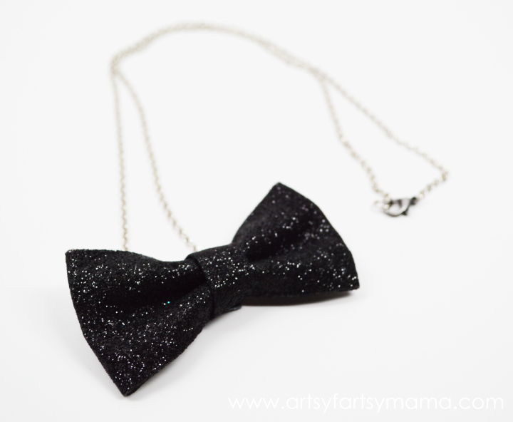 DIY Bow Tie Necklace from artsyfartsymama.com #jewelry #ribbon