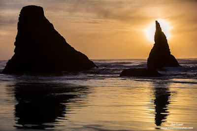Sunset behind sea stacks at Bandon Beach along the Oregon coast, Oregon, USA.