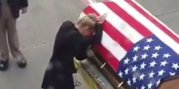 Heartbreaking moment a grieving widow meets her husband's coffin on the airport tarmac