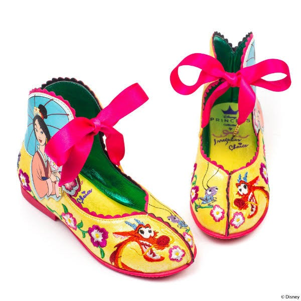 yellow childrens shoes with Mulan embroidery and pink ribbon
