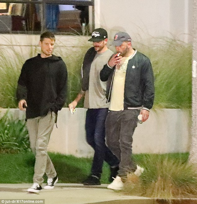 Ben Affleck pictured as he puffs on cigarette during outing with male pals after rehab