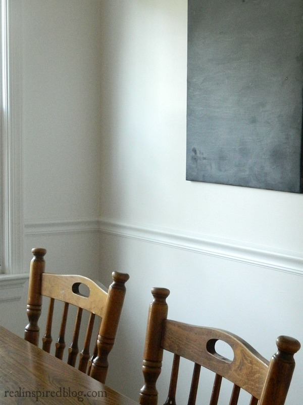 snowbound white walls wooden dining table and chairs diy chalkboard canvas