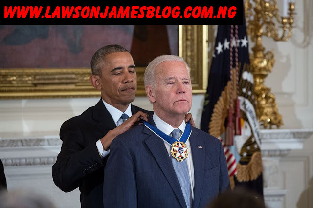 President Obama awarding the Presidential Medal of Freedom with Distinction to Vice President Biden.