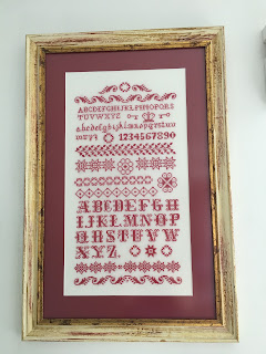 Cross stitch sampler in the bathroom