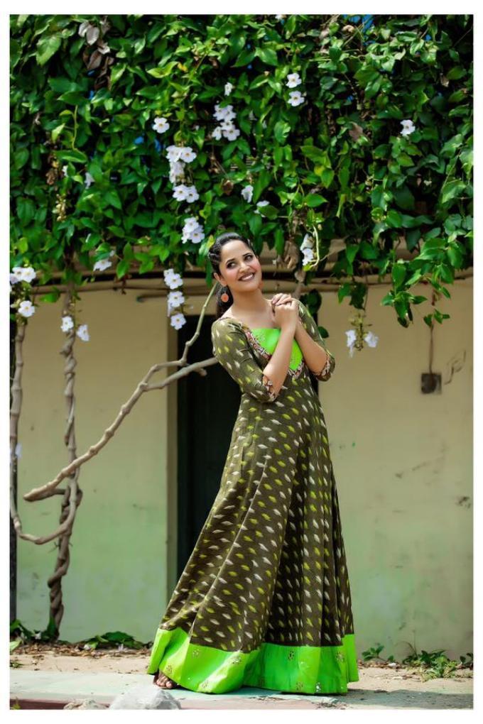 Telugu TV Anchor Anasuya Photoshoot In Green Gown