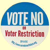 Blue and white circular VOTE NO on voter restriction sticker