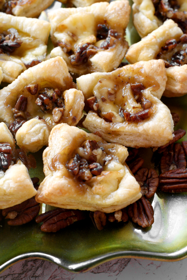 Maple Pecan Brie Bites are mini two-bite puff pastry cups filled with Brie and a sweet maple pecan sauce.  They are sure to be your new favorite holiday appetizer! #ad