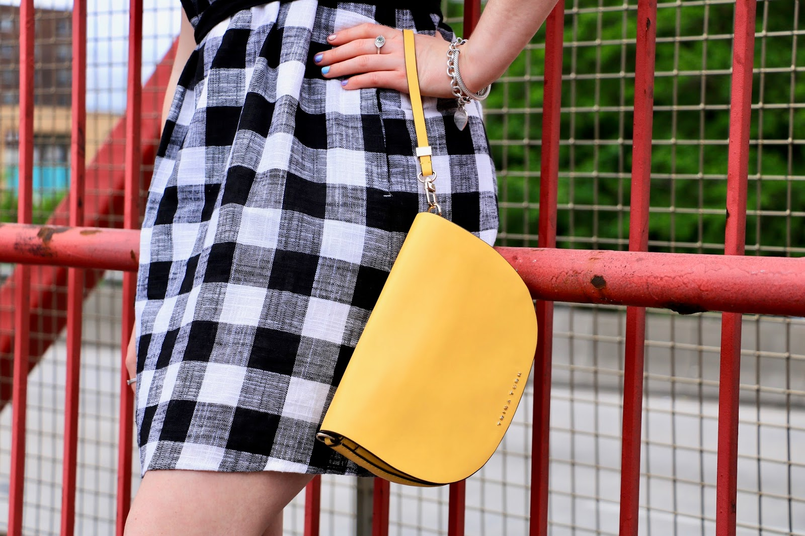 New York fashion blogger Kathleen Harper with yellow Trina Turk clutch