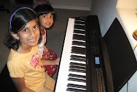 girls playing piano