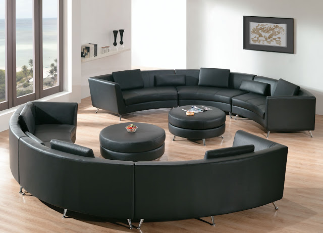 amazing black double curved leather sofa with two round tables plus brown wooden floor