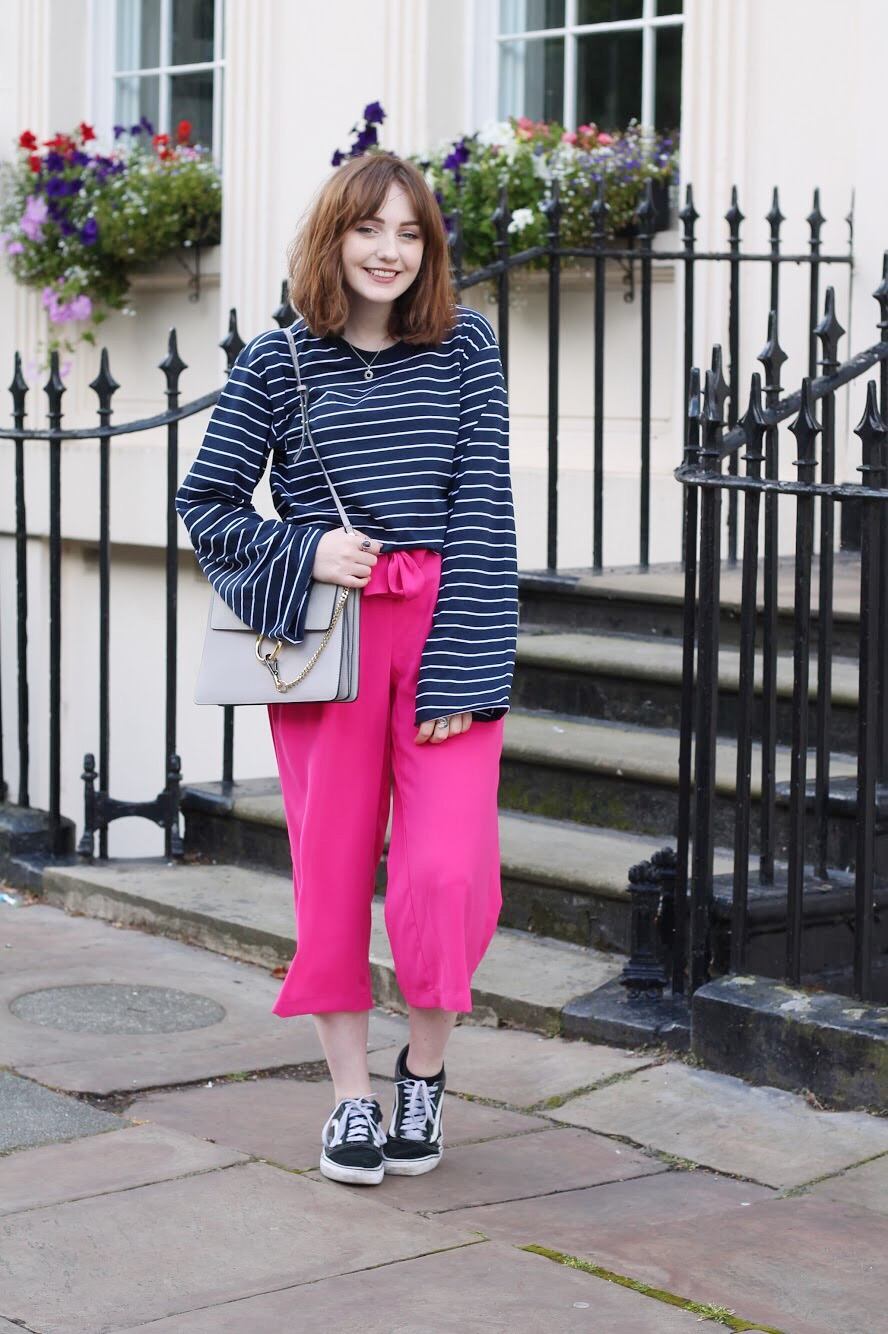 Liverpool fashion blogger outfit featuring monki oversized stripe top, pink culottes, vans old skool trainers and grey bag