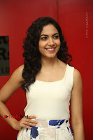 Actress Ritu Varma Stills in White Floral Short Dress at Kesava Movie Success Meet .COM 0080.JPG