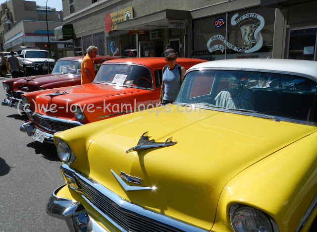 yellow, orange and red chevy's in a row on the street