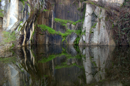 Abandoned rock quarry water reflection