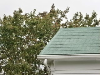 Tin roof repair of roof edges improved the appearance of the structure and protected edges from rusting