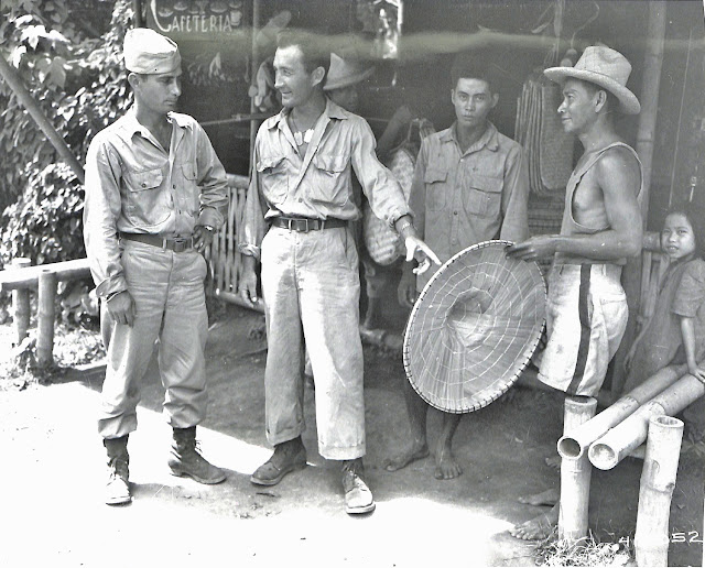 S/Sgt. John Nesteruk, Pacific veteran, in conducting his brother, T/S Michael Nesteruk, who arrived from France, on a Philippine shopping tour.  The two brothers are from Youngstown, Ohio.  Taken 28 July 1945.