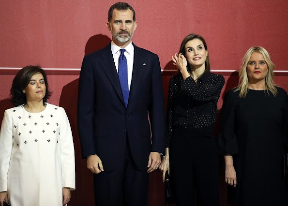 Queen Letizia wore Uterque Blouse, carried Nina Ricci Arc Clutch, Magrit Shoes, Tous Jewelry Earrings, wore Boss Trousers