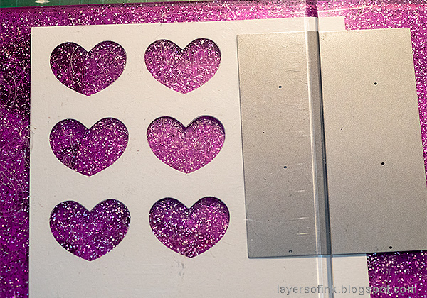 Layers of ink - Mixed Media Heart Windows Tutorial by Anna-Karin Evaldsson. Die cut the heart windows.