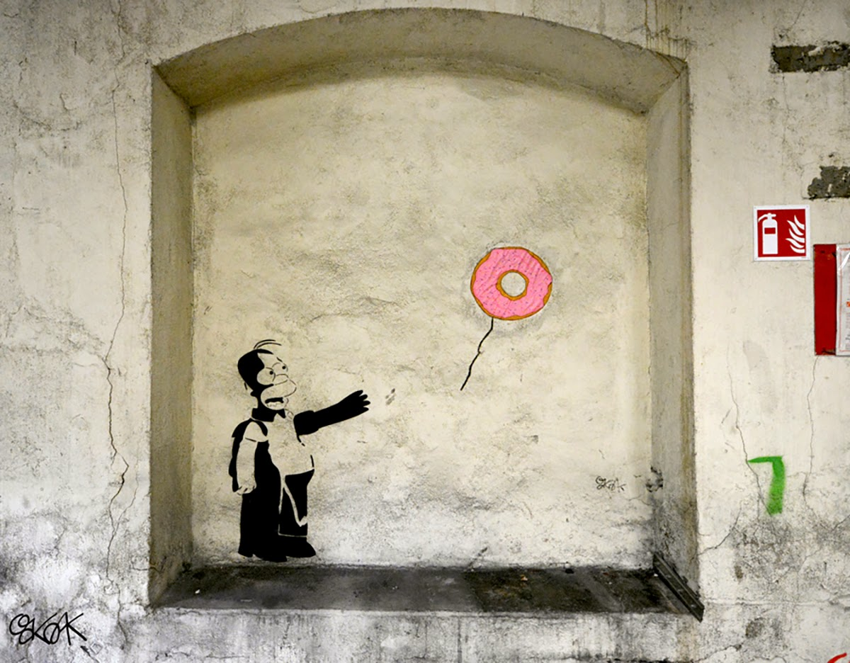 "Our friend OakOak is currently in his hometown of Saint-Etienne in France where he just unveiled an epic new piece. Entitled ""Banksy Vs Homer"", the French artist spoofed Banksy's ""Girl With Balloon"""