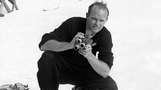warren miller taking a photograph