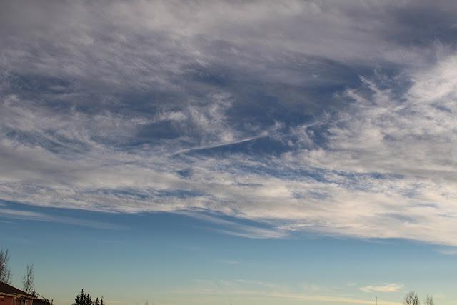 blue sky, wispy clouds