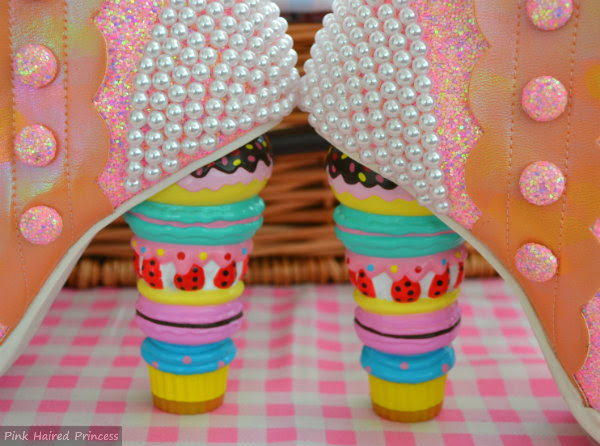 macaron heels and pearl detail on boots facing each other