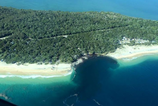 Why did the sink hole happen at Rainbow Beach?