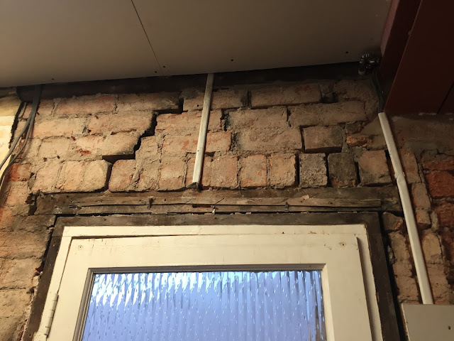 cracks above door