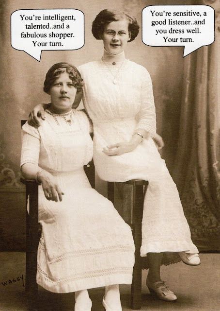 picture from the Edwardian era showing two women in white dresses