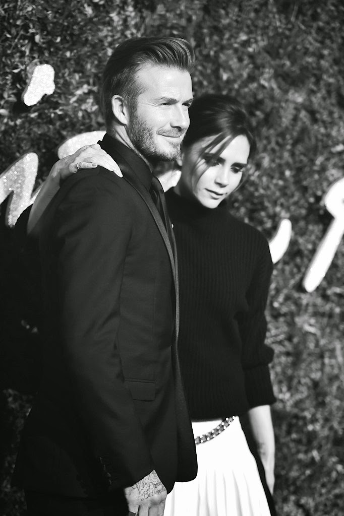 Victoria Beckham with David Beckham in Dior Homme tuxedo at 2014 British Fashion Awards
