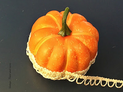 Vintage, Paint and more... gluing the buttonhole trim around a dollar store pumpkin to make a lacy vintage pumpkin for fall