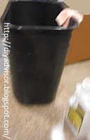 This is an ordinary black kitchen trash can