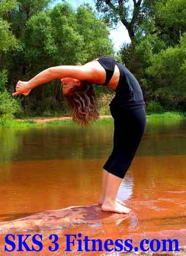 A yoga girl is doing Ardha Chakrasana | Half Wheel Pose or Standing Backbend