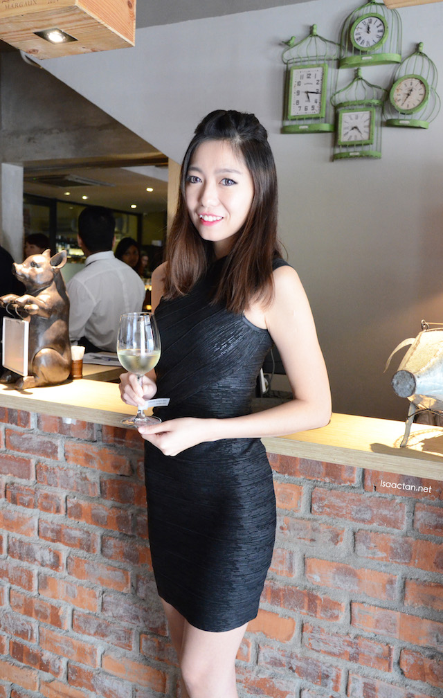 Welcome to an afternoon of food and wine pairing, says the pretty lady in black