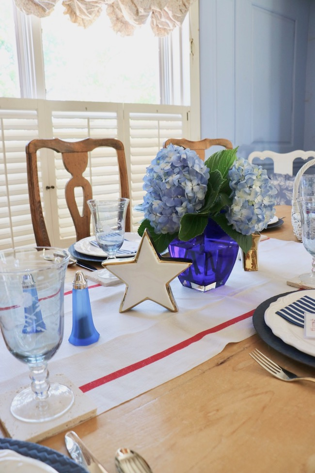 set a stars and stripes patriotic table with a vintage French linen towel