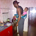 Daddy Duties! Gbenro Ajibade straps daughter to his back while preparing a meal