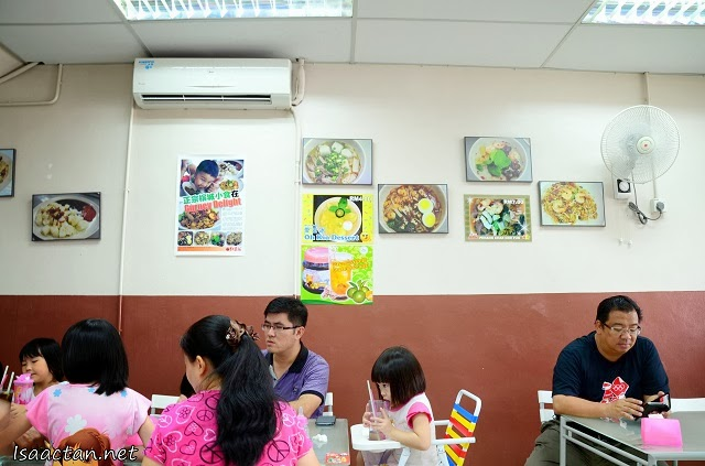 Simple decor with some of their signature dishes pictured on the wall